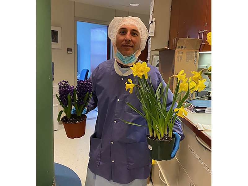Photo of medical staff receiving flowers