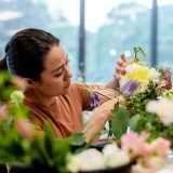 A student working on a floral arrangement