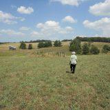 Photo of a woman walking in a field.