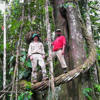 Photo of Douglas Daly and Edilson de Oliveira standing on a vine in the Amazon
