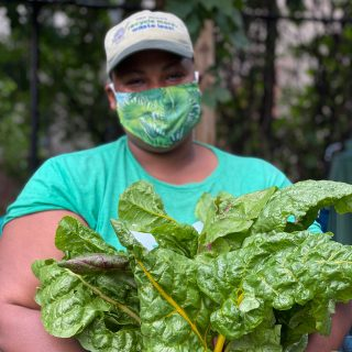 Photo of Kadeesha Williams holding leafy greens