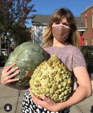 Photo of a volunteer delivering pumpkins
