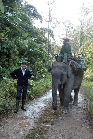 Photo of Andrew Henderson with an elephant