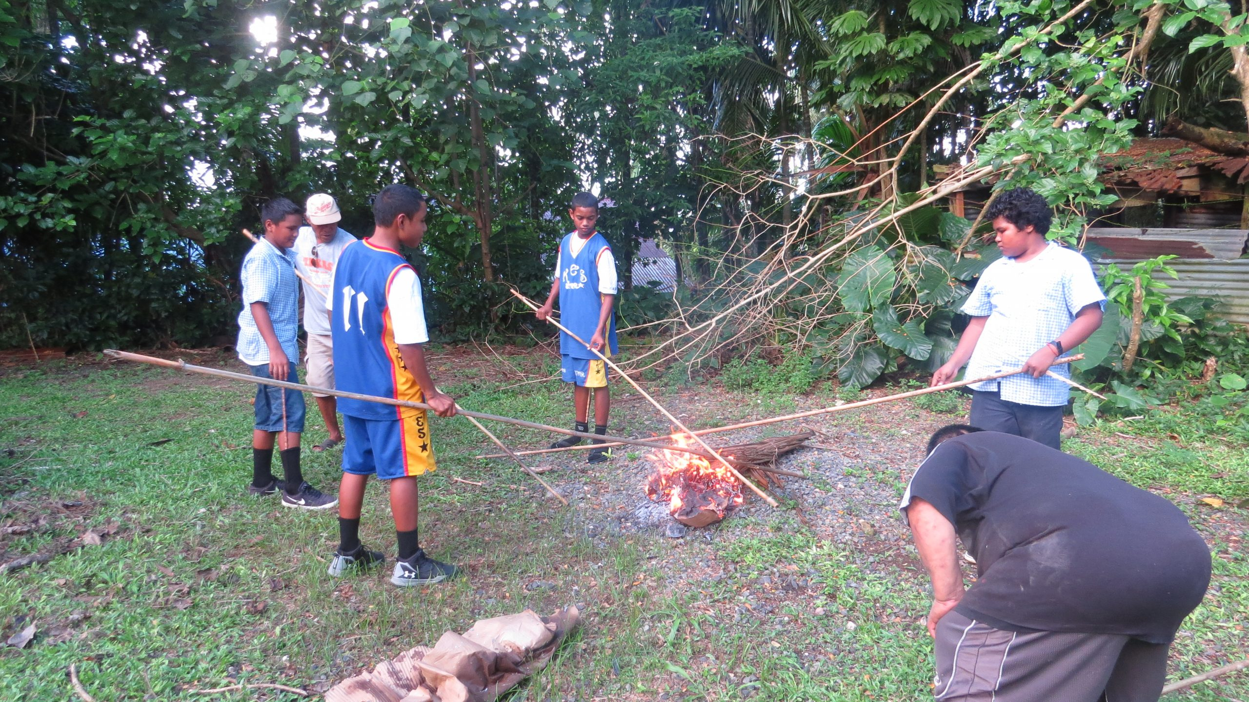 Photo of Palau residents learning how to make traditional fishing spears