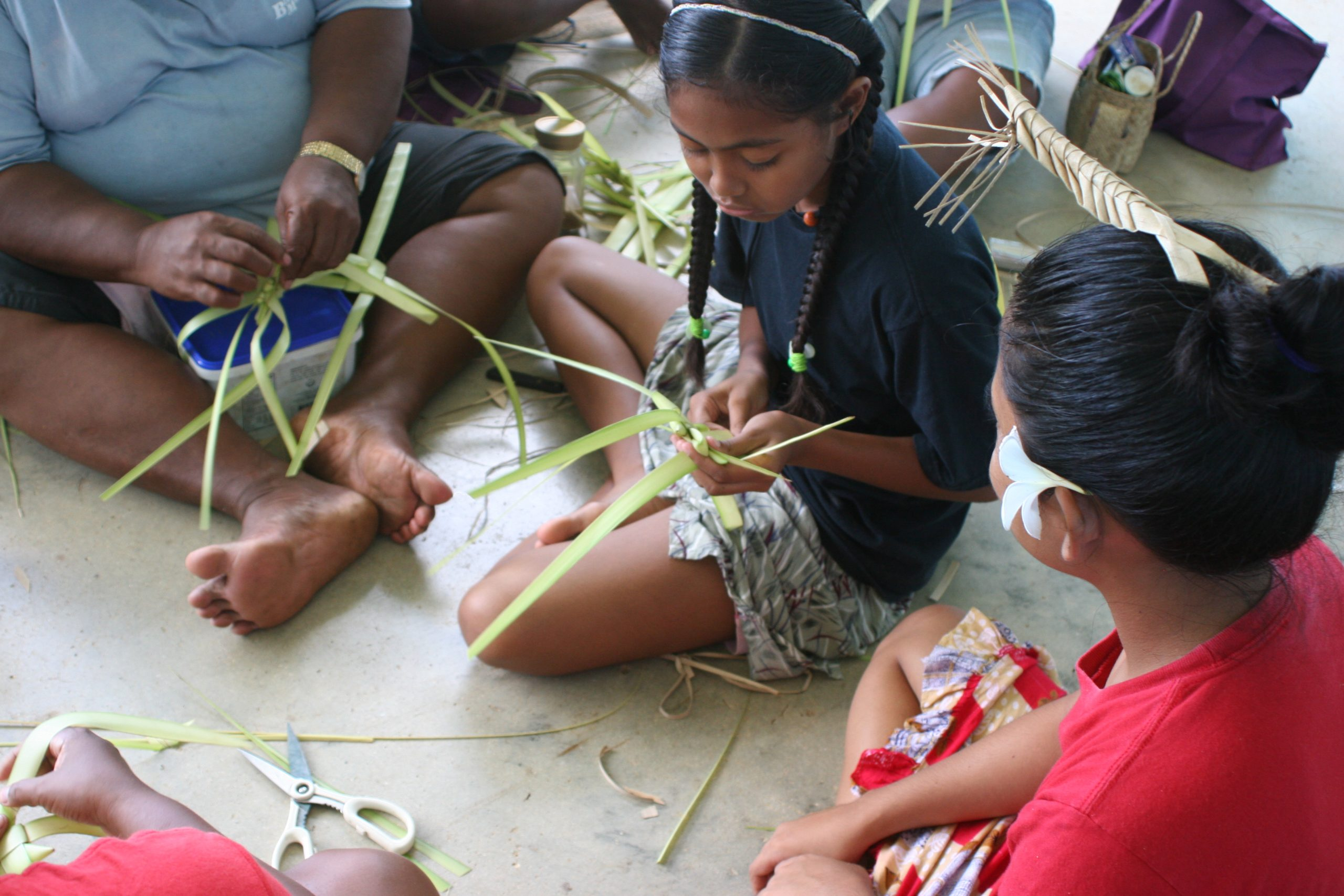Photo of children learning how to make traditional toys from leaves