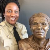 An image of Ranger Angela Crenshaw with a bust of Harriet Tubman