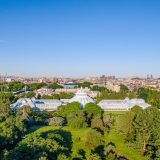 An aerial view of the Enid A. Haupt Conservatory and New York City